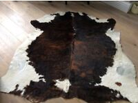 Cowhide rug with couhions lovely shinny addition to your home.