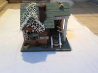 Hanging fishing house ornament
