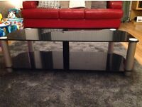 "Black glass TV stand, can hold up to 50"" tv., width 120cm, depth 45cm & height 35cm"