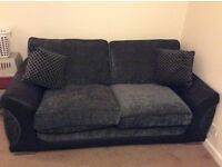 Black and grey 2 seater bed settee.