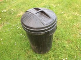 Black plastic dustbin with lid
