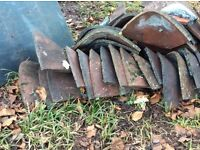 Old clay hip roof tiles