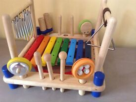 Wooden musical toy with xylophone, shakers, drum, triangle