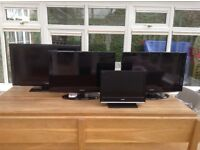 5 TVs for sale, assorted sizes, being sold together