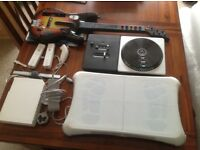 Wii consoles and games including wii fit board, guitar hero and dj hero