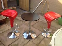 Bar stools with drinks table