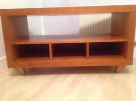 Wood veneer tv unit.
