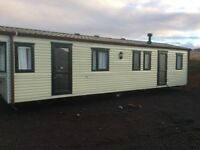 Static caravan fully double glazed with gas central heating