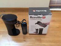 Coffee Maker: Single travel mug included