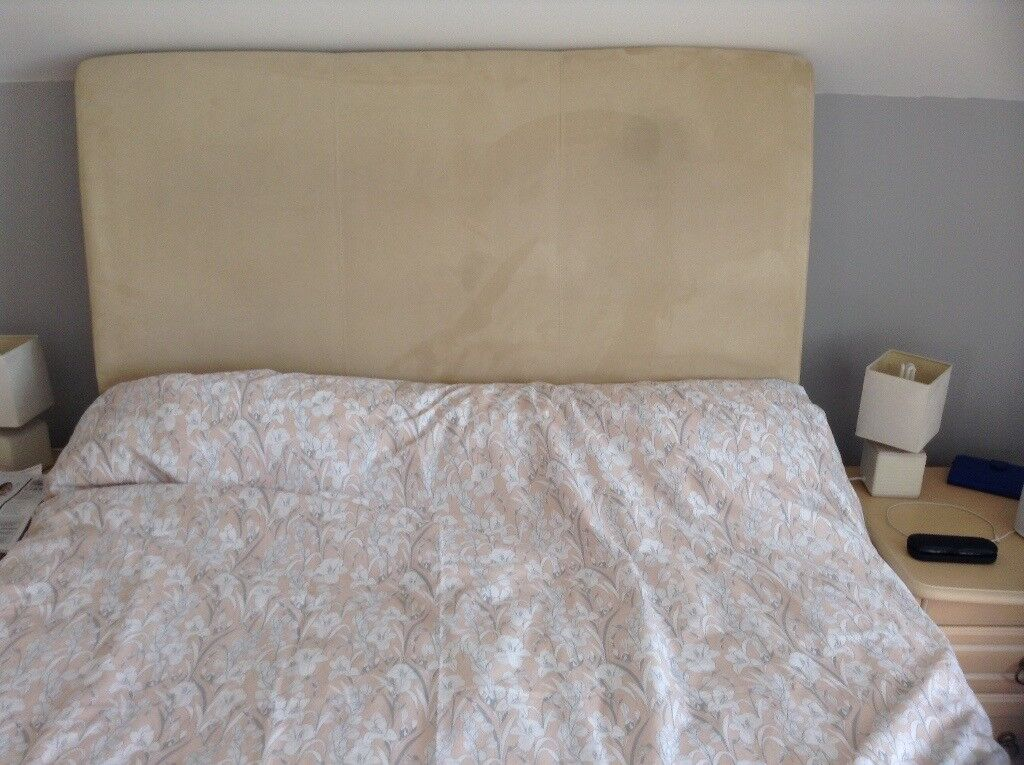 Padded beige headboard for double bed