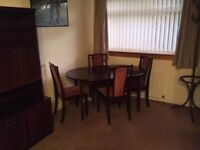 Meredew dark wood extending table, 4 chairs and display unit