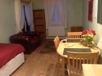 Self contained furnished ground floor studio flat with own enterance