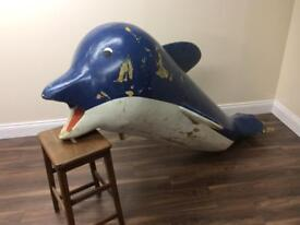 Large funky fibreglass dolphin, crazy golf.. water feature?