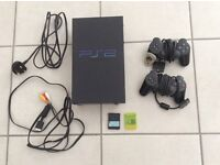 Black PS2 Sony PlayStation 2 console bundle with games. £25 Dereham