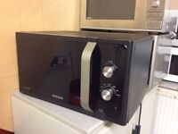 Samsung microwave MS23F301EAK with 3 month warranty