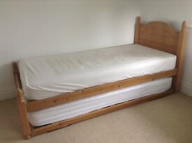 Pine single bed frame and truckle in good condition