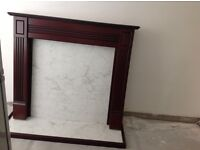 Used but in good condition, mahogany fire surround and marble effect Hearth.