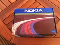 Nokia mobile phone, hands free car speaker kit not used.