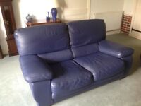 3seater navy leather Natuzzi sofa and footstools. Good condition.