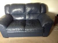 Two seater blue leather sofa, very comfortable, used condition