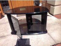 Good condition black and glass tv unit