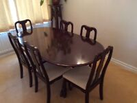 Extending Dining table with 6 matching chairs for sale