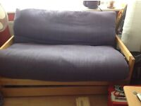 Double futon sofa bed, storage draw underneath 2 sets covers , good condition