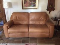 Leather sofa with electric reclining control