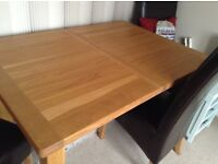 Solid Oak Extendable Dining Table & 4 Good quality Dark Brown Leather Chairs