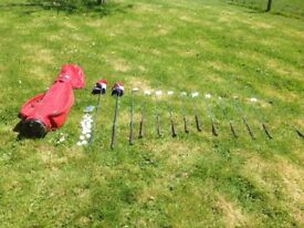 Set of Golf clubs for sale with tees and balls in a Wilson golf bag. Good Condition.