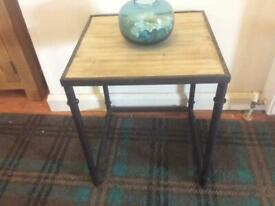 On trend metal and wood small table.