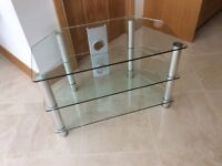 Television stand - chrome legs with three glass shelves - as new - ex John Lewis