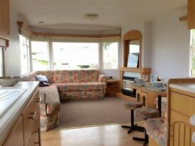 PRIVATE SALE--Cheap lovely 2 bedroom caravan sited on st.osyth holiday park essex