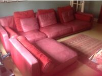 Corner sofa: red leather - main piece nearly 10 feet long - good condition - viewers welcome