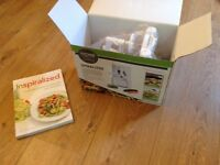 Spiralizer as new and recipe book (used) make delicious vegetarian meals!