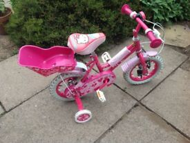 Childs 12 inch Sweetie bike with Hello Kitty padded seat and bell