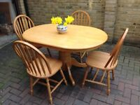 Oval solid wood dining table and 4 chairs