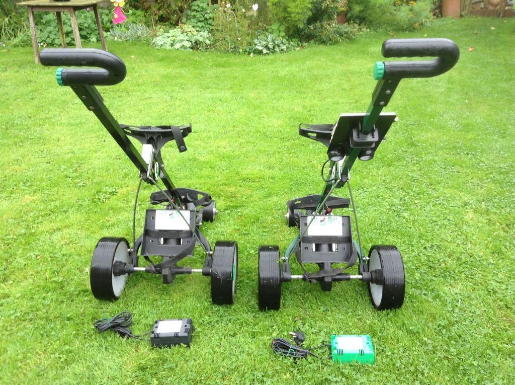 Golf trolleys and clubs