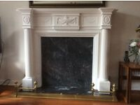 Fireplace with marble back panel and hearth