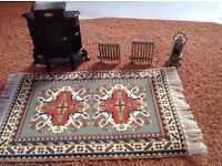 Collection of dolls' house furniture, rug, crockery, garden plants, radiators etc.