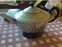 Silver coloured vintage teapot