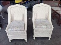 2 wicker chairs with cushions