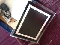 Digital photo frame with LED light edge.