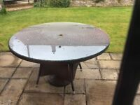 Brown Patio Rattan round glass top table and 5 chairs