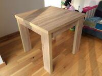 NEXT extending dining room table from Corsica range (natural light oak)
