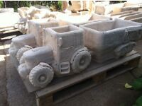 Concrete tractor and trailer planter
