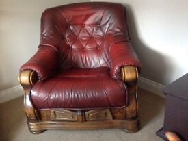 Leather arm chair with wood trim and draw