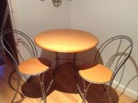 Bistro table and chairs. Table 75cm diameter. Good condition,