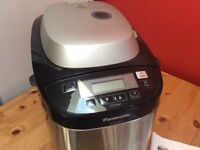 As new Panasonic SD-ZB2502 bread maker with instructions and recipes