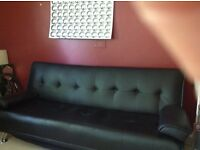 Couch/bed. Modern black faux leather bedsettee ideal for sleep overs